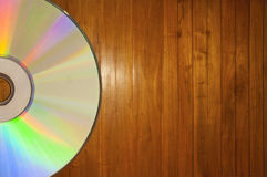 Compact disc on a Wooden Background. With copy space Royalty Free Stock Photo