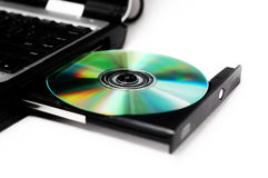 Compact discs. Isolated notebook with compact disc on a white background Royalty Free Stock Image