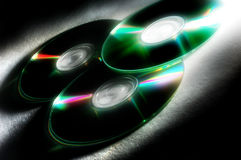 Compact discs. Few compact discs on a black background Stock Images