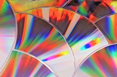 Compact discs. Reflection on the compact disks surface stock images