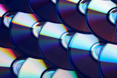 Compact discs background. Several cd dvd blu-ray discs. Optical recordable or rewritable digital data storage. Background Royalty Free Stock Image