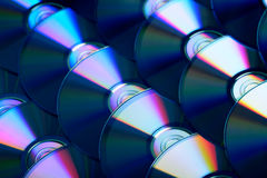 Compact discs background. Several cd dvd blu-ray discs. Optical recordable or rewritable digital data storage. Background Stock Photo