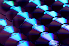 Compact discs background. Several cd dvd blu-ray discs. Optical recordable or rewritable digital data storage. Royalty Free Stock Image