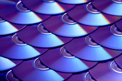 Compact discs background. Several cd dvd blu-ray discs. Optical recordable or rewritable digital data storage. Stock Image
