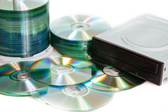 Compact discs and burner on a white background Stock Image