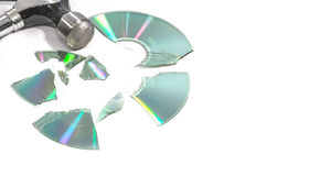 Compact discs (Cds) broken by a hammer Stock Image