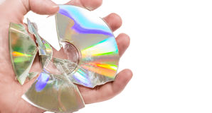 Compact discs (Cds) broken, held in the hand Royalty Free Stock Photography