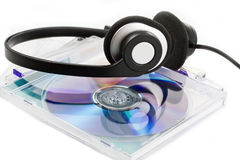 Compact Discs (CDs) with headphones Royalty Free Stock Photo