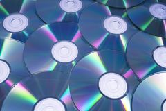 Compact Discs or CDs. A shot of shiny Compact Discs or CDs, over a white background royalty free stock photography