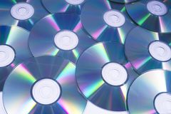 Compact Discs or CDs. A shot of shiny Compact Discs or CDs, over a white background royalty free stock photos
