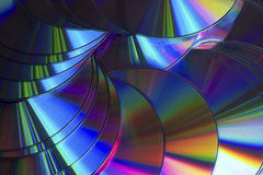 Compact Discs Colour Reflections. Pile of Discs spread out reflecting multiple colours Stock Photography