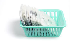 Compact Discs in Plastic Basket Royalty Free Stock Photography