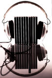Compact discs plugged-in into headphones Royalty Free Stock Photo