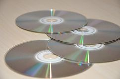 Compact discs on table Royalty Free Stock Image