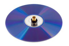 Compact disk. Music compact disk with jack plug isolated on white background Stock Photos