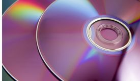 Compact disk. CD\DVD compact disks background close up with rainbow Royalty Free Stock Photography