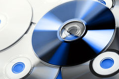 Compact disk. Group of compact disk, one on blue lighting Stock Images