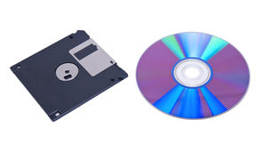 Compact disk and floppy. Isolated on white background Stock Photography