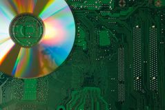 Compact disk and motherboard Royalty Free Stock Photography