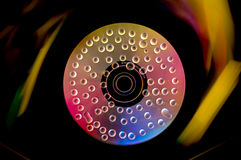 Compact Disk with water drops and vibrant colors Royalty Free Stock Photo