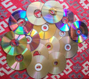 Compact disks collection on the table Royalty Free Stock Image