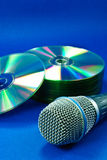Compact Disks and Microphone Royalty Free Stock Image