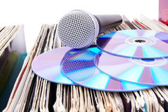 Compact disks and microphone on records Stock Photography