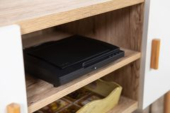 Compact DVD player in the interior on the TV Cabinet royalty free stock photography