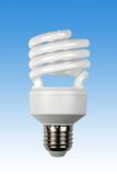 Compact energy saving bulb. Fluorescent efficient power saving light bulb including clipping paths Royalty Free Stock Images