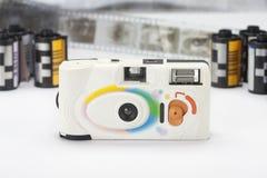 Compact film camera and flim cartridge Royalty Free Stock Image