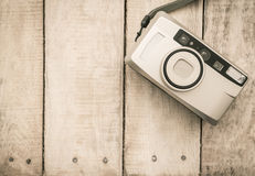 Compact film camera on wood Royalty Free Stock Images