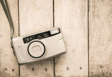Compact film camera on wood Stock Photo