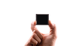 Compact Flash Memory Card. Hand Holding Up a Compact Flash CF Memory Card with Custom Space Stock Photos