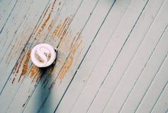 Compact flourescent light bulb. An energy efficient compact fluorescent light bulb in a ceiling with peeling paint royalty free stock images