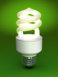 Compact Fluorescent Bulb. Glowing compact fluorescent bulb on rich green backdrop royalty free illustration