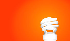 Compact Fluorescent Bulb on orange background (CFL). Compact Fluorescent Bulb on orange background CFL Royalty Free Stock Images