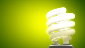 Compact fluorescent lamp. Green background, ecological metaphor Royalty Free Stock Images