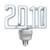 Compact fluorescent lamp (CFL) 2010. Concept of modern fluorescent light bulb isolated against the white background. 2010 number shaped multiple turn glass Stock Image
