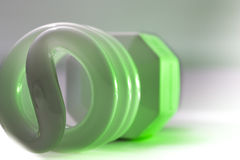Compact Fluorescent light with green glow Stock Photo