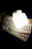 Compact Fluorescent Lightbulb and dollar Stock Photos