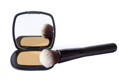 Compact foundation with brush and mirror isolated in white backg Royalty Free Stock Photos