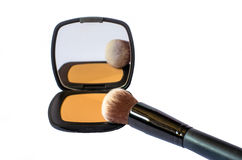 Compact foundation with brush and mirror isolated in white backg Stock Image