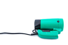 Compact green hair dryer Stock Photo