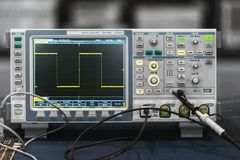 Compact industrial oscilloscope on desk. Closeup photo Royalty Free Stock Photography