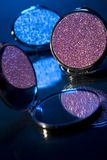 Compact mirrors. Cosmetic on glass Royalty Free Stock Photo