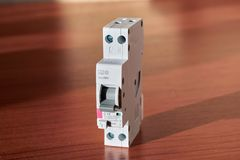 Compact narrow two-pole differential current circuit breaker stock image