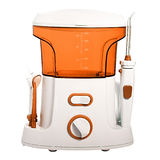 Compact orange Oral irrigator of the oral cavity intended for washing the garbage and soft dental patch from the stock photography