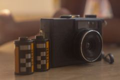 Analog camera with its 35mm films royalty free stock image