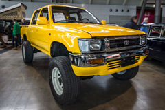 Compact pickup truck Toyota Hilux, 1992. STUTTGART, GERMANY - MARCH 03, 2017: Compact pickup truck Toyota Hilux, 1992. Europe`s greatest classic car exhibition Royalty Free Stock Images