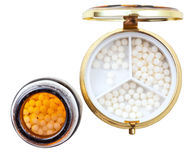 Compact pill box and jar with homeopathy balls Stock Photo